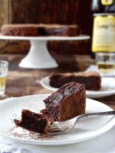 For the grown ups only! This SUNKEN DRUNKEN CHOCOLATE CAKE is rich, luscious and decadent and gluten free | Plus Ate Six